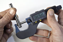 Micrometer. Checking the diameter of a pin with a micrometer stock photos