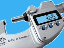 Micrometer. The electronic micrometer the exact tool on the job royalty free stock photography