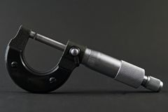 Micrometer. At the black background stock photos