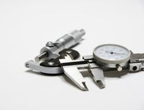 Micrometer and Caliper. Picture of micrometer and caliper isolated on white background royalty free stock photography
