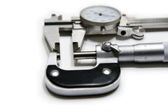 Micrometer and Caliper. Picture of micrometer and caliper isolated on white background Stock Image