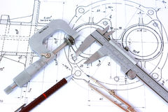 Micrometer, Caliper, Mechanical Pencil and Compass. On Blueprint royalty free stock images