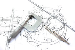 Micrometer compass and ruler on blueprint Royalty Free Stock Photo