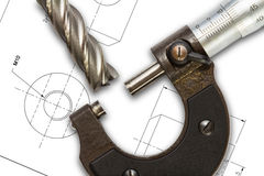 Micrometer. And end mill cutter, on drawing background with clipping path stock photography