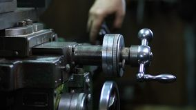 Micrometer wheel on the lathe machine stock video