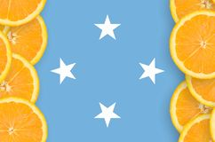 Micronesia flag in citrus fruit slices vertical frame royalty free stock photography