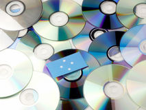 Micronesian flag on top of CD and DVD pile isolated on white Stock Photo
