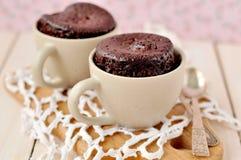 Bolos do copo do chocolate Imagens de Stock