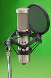 Microphone 1. Studio silver steel microphone in green room stock image