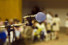 Microphone. One microfon, background the audience stock photo