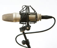 Microphone. Old grey  microphone with cable Royalty Free Stock Images