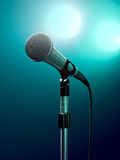 Microphone. On stage with turquoise stage lights royalty free stock photos