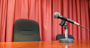 Microphone. On tripod stand on a table in a room Stock Image