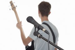 Microphone. Microphone close-up, the musician not in focus Royalty Free Stock Photography