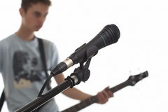 Microphone. Microphone close-up, the musician not in focus stock photos