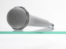 Microphone. Isolated on the glass table Royalty Free Stock Images