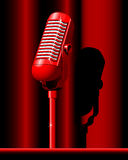 Microphone. Red retro Microphone on the red background Stock Photos
