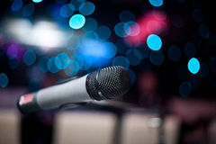 Microphone. In nightclub on the background of blurry lights Stock Photography
