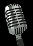 Microphone. Classic microphone against a black background. 3D render Stock Photography