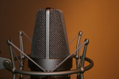 Microphone. Professional studio recording microphone on shock mount royalty free stock photos