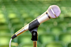 Microphone. Photograph of microphone in front of an empty auditorium Stock Photo