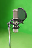 Microphone 2. Studio silver steel microphone in green room stock images