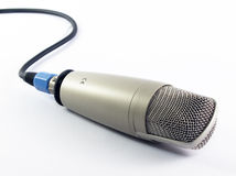 Microphone-2. A microphone and wire with white background Royalty Free Stock Images
