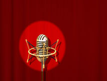 Microphone. Retro professional microphone over red curtain Royalty Free Stock Photo