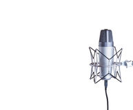 Microphone. Condenser microphone with copy space isolated on a white background royalty free stock images