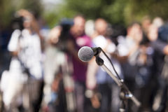 Microphone. At a press conference Royalty Free Stock Images