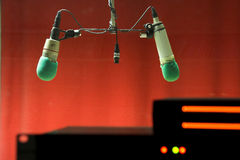 Microphone. Two Microphone against red background Stock Images