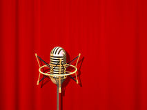 Microphone. Retro professional microphone over red curtain Stock Photography