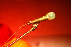 Microphone. Close-up of a microphone on stage, red color is from reflector (not filtered Stock Image
