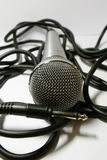 Microphone. On a white table royalty free stock photos