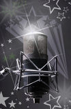 Microphone. A vintage silver microphone on the stars Stock Photo