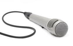 Microphone. A silver microphone on a white background royalty free stock image