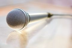 Microphone. Silver steel microphone lying on the table stock photography