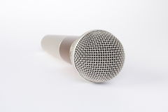 Microphone. A microphone on a white background stock photo