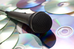 Microphone. And cd on the table Royalty Free Stock Photos