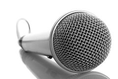 Microphone. Close-up silver microphone with reflection, isolated on white stock images