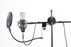 Microphone. Studio microphone on a stand on white background stock photo