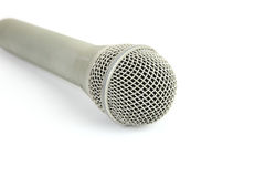 Microphone. Close up of hand held microphone on white background royalty free stock image