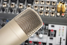 Microphone. Studio microphone on the audio control console background Stock Images