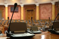 Microphone. S in the empty conference room, small DOF Royalty Free Stock Image