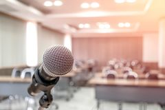 Microphone on abstract blurred of speech in seminar room royalty free stock photography