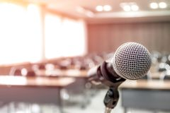 Microphone on abstract blurred of speech in seminar room stock photo