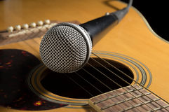 Microphone on acoustic guitar Stock Photos