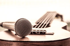 Microphone on acoustic guitar. In vintage color tone Royalty Free Stock Photos