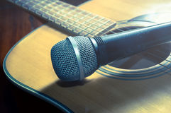Microphone on acoustic guitar,vintage filtered. Royalty Free Stock Photography