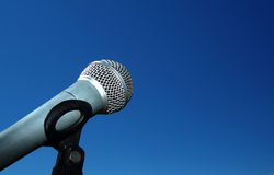 Microphone against blue sky Royalty Free Stock Photo